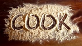 Write word on flour. Write and erase cook of flour finger stock video footage