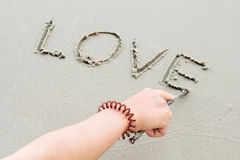 Write the word love letters on the sand Stock Image