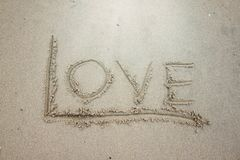Write the word love on the sand. royalty free stock photography