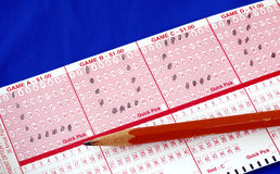 """Write the word """"Luck"""" on the lottery ticket Royalty Free Stock Image"""