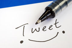 Write the word Tweet. And draw a happy smile Stock Photos