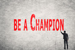 Write words on wall, Be A Champion Royalty Free Stock Photography