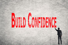 Write words on wall, Build Confidence Royalty Free Stock Photo