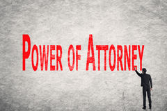 Write words on wall, Power Of Attorney. Asian business man write words on wall, Power Of Attorney Stock Photo