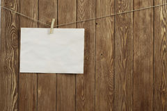 Write your message. Blank sheet of paper hanging on rope Royalty Free Stock Photography
