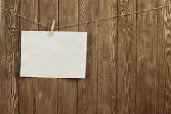 Write your message. Blank sheet of paper hanging on rope Stock Photography