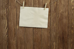 Write your message. Blank sheet of paper hanging on rope Royalty Free Stock Image