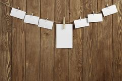 Write your message. Blank sheets of paper hanging on rope Royalty Free Stock Photography