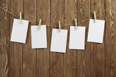 Write your message. Blank sheets of paper hanging on rope Stock Image