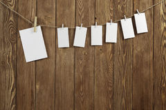 Write your message. Blank sheets of paper hanging on rope Stock Photos