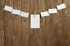 Write your message. Blank sheets of paper hanging on rope Royalty Free Stock Photo