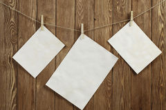 Write your message. Blank sheets of paper hanging on rope Stock Photography