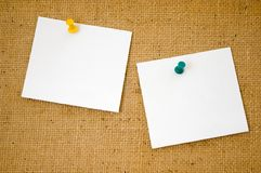 Write your own message on it!. Corkboard with blank notepapers Stock Photo