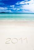 Writenn 2011 do ano na areia Imagens de Stock