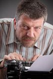 Writer. Middle age writer or journalist with typewriter royalty free stock photo