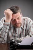 Writer. Middle age writer or journalist with typewriter royalty free stock photos