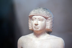 The writer Antique egyptian statuette close up stock photo
