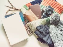 Writer with book in holiday and winter season travel flat lay co. Ncept from  winter cloth item and passport, sunglasses with copy space and isolated white Stock Photography