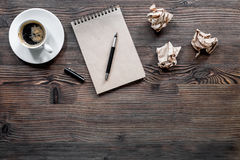 Writer concept. Coffee, vintage notebook and crumpled paper on wooden table background top view copyspace Stock Photos