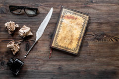 Writer concept. Feather pen, vintage notebook and crumpled paper on wooden table background top view copyspace Royalty Free Stock Photography