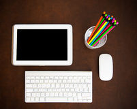 Writer desktop symbol with tablet and colorful pencils Stock Images