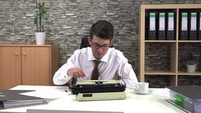 The writer does not know what to write on a typewriter