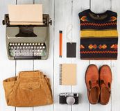 Writer is going on a journey - typewriter, notepad, camera, clot royalty free stock photos