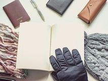 Writer in holiday and winter season travel flat lay concept from. Winter cloth item and passport, sunglasses with copy space and isolated white background Stock Photos