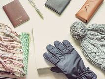 Writer in holiday and winter season travel flat lay concept from. Winter cloth item and passport, sunglasses with copy space and isolated white background Royalty Free Stock Image