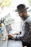 Writer Journalism Imagination Novelist Message Concept. Senior man writing note cafe Stock Photography