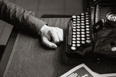 Writer for the old typewriter. Writer at the old typewriter stock images