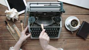 Writer with retro writing machine. Writer cleans retro writing machine. View from above stock footage