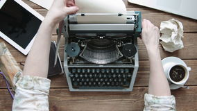 Writer with retro writing machine. Writer refill paper in old typewriter. View from above stock video footage