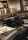 Writer`s abandoned office. Vintage typewriter and phone on a table with books and text sheets, at the foreground of an old library. Abandoned office of a writer vector illustration
