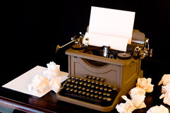 Writer's Block. A vaintage typewriter with several wadded up pieces of paper arranged around it.  symbol of writer's block or difficulty with creativity Stock Photography