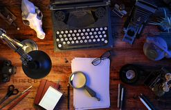 Writer`s desk table with typewriter, vintage phone, camera, skull, supplies, box of cigars. Top view. 3D illustration vector illustration