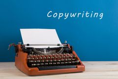 "writer's workplace - typewriter on blue blackboard background with text ""Copywriting royalty free stock photos"