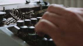 Writer typing with retro writing machine. Side view stock footage