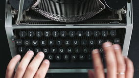 Writer typing with retro writing machine. View from above stock video