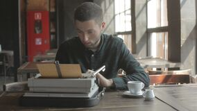 Writer uses a classic typewriter to work. something about slowing down