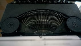 Writer using a retro typewriter, upper view slow motion. Hd video stock footage