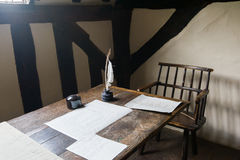 Writer work place. Medieval writer work place. Old style writing objects on a table royalty free stock photography
