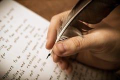 Writer writes a fountain pen on paper work Royalty Free Stock Photo