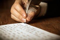Writer writes a fountain pen on paper work Royalty Free Stock Photos