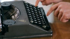 Writer writing with retro typewriter, close up. Hd video stock footage