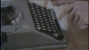 Writer writing with retro typewriter, close up, old film. Hd video stock footage