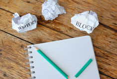 Writers block. Crumpled pieces of paper next to a broken pencil Stock Image