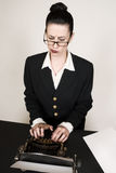 Writers Block. Retro business woman with vintage typewriter Stock Image