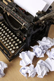 Writers block. Retro typewriter with paper scattered all around - conceptual image for creative block Stock Image