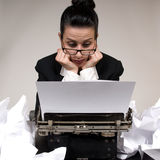 Writers Block. Retro business woman with vintage typewriter royalty free stock photo